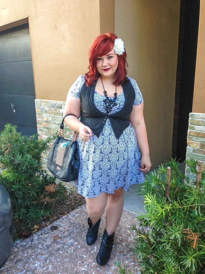 plus size outfit with damask dress, vest, and statement necklace