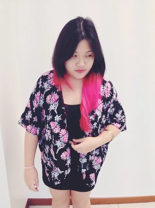 woman wearing pink and black flowered kimono with black and pink ombre hair