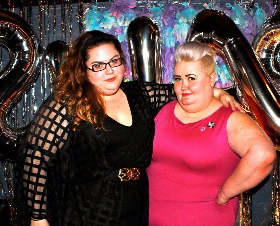 two fat babes in black and pink at a party