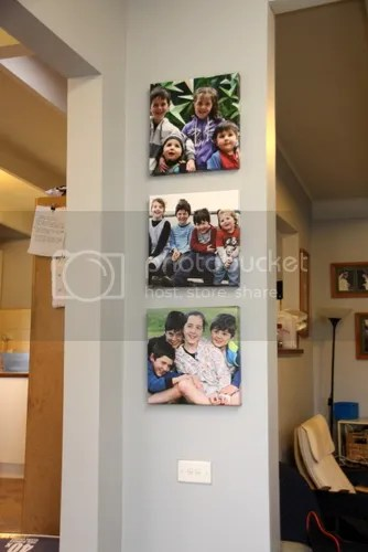 Just to show you the photos, hung on the wall directly opposite the wall when you walk in.