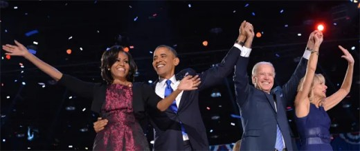 image of First Lady Michelle Obama, President Barack Obama, Vice President Joe Biden, and Dr. Jill Biden onstage at the Team Obama victory rally last night, raising their arms in celebration as red, white, and blue confetti falls around them