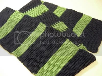 So yeah, green & black stripes! First time doing colored stripes, so to keep it easy I just did a stockinette stitch. I used my trusty 7 circular needles, and did 42 stitches across and kept on knitting for about 58 inches. The green stripes are all different sizes; Id like to say its because Im creative, but really its becasue I fudged up the first few stripes so I just went with it! Oh, and used cotton yarn so it can be machine-washed for easy care.
