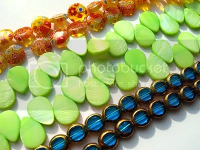 These are the beads, all necklaced up! Pretty, huh? The orange ones look like candy.