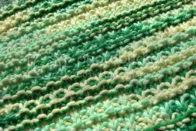 Melanie gave me this yarn to use, I think the color is Shades of Green. The yarn was very soft, so with the colors it reminded me of a soft peppermint, except since its green it would be a spearmint. Mmmmmm.