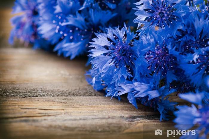 Carta da Parati Fiordalisi su sfondo in legno fiori blu