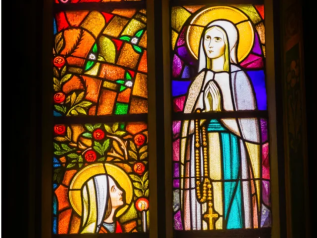 """To become the mother of the Savior, Mary """"was enriched by God with gifts appropriate to such a role."""" The angel Gabriel at the moment of the annunciation salutes her as """"full of grace."""" In fact, in order for Mary to be able to give the free assent of her faith to the announcement of her vocation, it was necessary that she be wholly borne by God's grace.Through the centuries the Church has become ever more aware that Mary, """"full of grace"""" through God, was redeemed from the moment of her conception. That is what the dogma of the Immaculate Conception confesses, as Pope Pius IX proclaimed in 1854:The most Blessed Virgin Mary was, from the first moment of her conception, by a singular grace and privilege of almighty God and by virtue of the merits of Jesus Christ, Savior of the human race, preserved immune from all stain of original sin. (CCC 490-491)"""