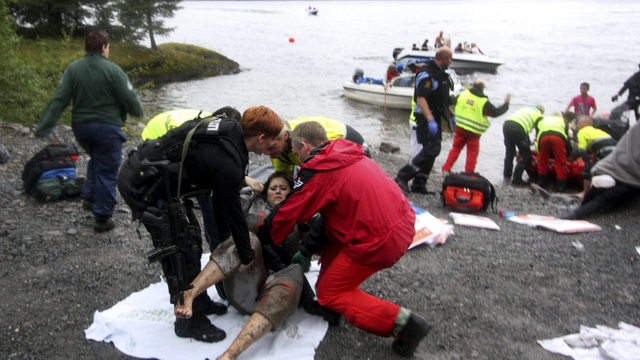 Rescuers tend to a frightened woman on Uteoya