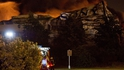 Firefighters battle a blaze at a Sony distribution centre