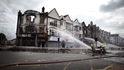 Fire crews deal with the aftermath of the riots on Croydon