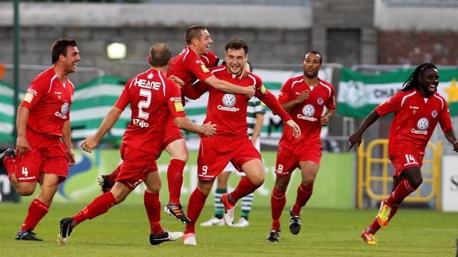Mark Quigley's Sligo Rovers team-mates celebrate his opener at Tallaght Stadium