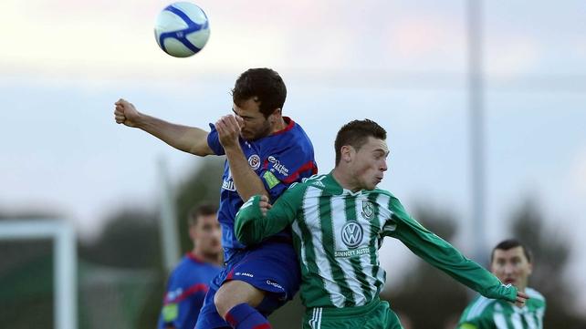 Sligo's Ross Gaynor challenges Bray's John Mulroy for a high ball