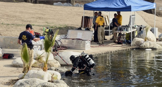 Divers were looking for electronic devices, a hard drive and other items linked to the shooters