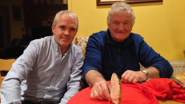 Vincent O'Brien and Noel McDonagh, Waterford History Group, with the flint axe