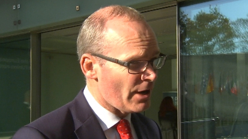 Simon Coveney said the British PM must make good on her commitments