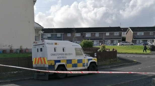 Police at the scene in Creggan Heights, Derry, before rioting broke out
