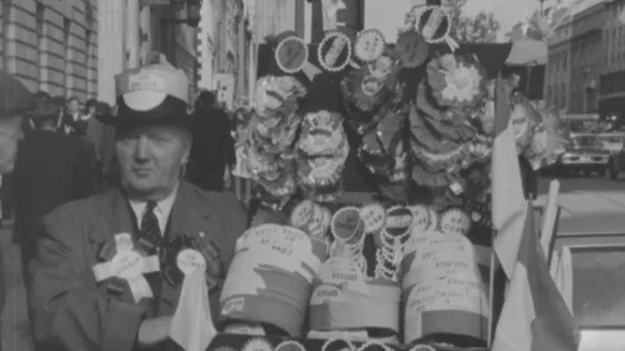 Hat and rosette seller on the final day of All-Ireland football, O'Connell Street (1971)