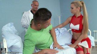 Sexy blonde nurse Bibi Noel sucks two dicks at the hospital porn image
