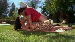 Lisa Ann fucks doggy and missionary styles outside on the lawn porn image