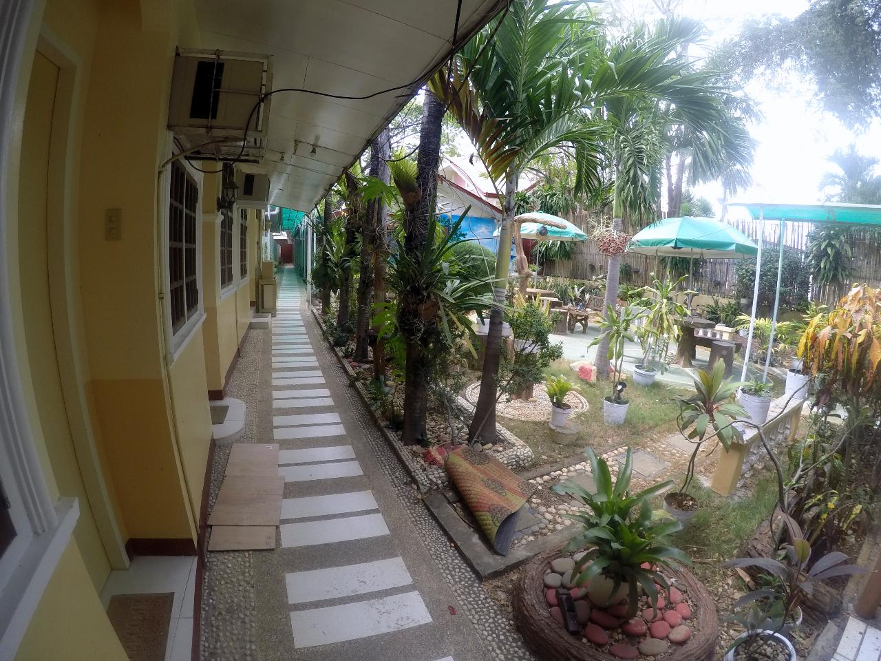 D Lucky Garden Inn Budget Economy Room - WORLD HOLIDAY TRAVEL AND TOURS PALAWAN