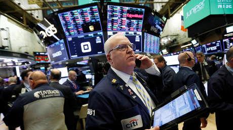 Corredores en el parqué de la Bolsa de Nueva York.