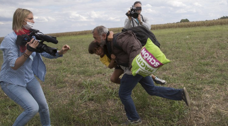 Camerawoman trips refugee