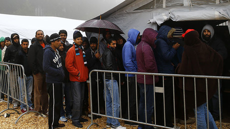 Migrants queue to get into a food tent at a temporary registration centre in the village of Schwarzenborn, northeast of Frankfurt, Germany. © Kai Pfaffenbach