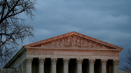 The top of U.S. Supreme Court building is lit at dusk in Washington © Joshua Roberts