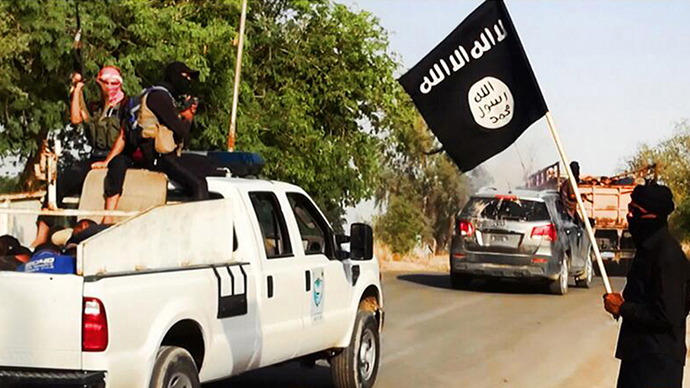 An image uploaded on June 14, 2014 on the jihadist website Welayat Salahuddin allegedly shows militants of the Islamic State of Iraq and the Levant (ISIL) transporting dozens of captured Iraqi security forces members to an unknown location in the Salaheddin province ahead of executing them (AFP Photo / HO)