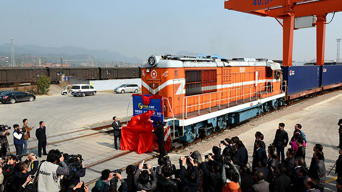 "Journalists wait to take photos of the first cargo train ""Yixinou"" from China's Yiwu to Spainish capital Madrid in a train station in Yiwu, east China's Zhejiang province on November 18, 2014. (AFP Photo/China Out)"