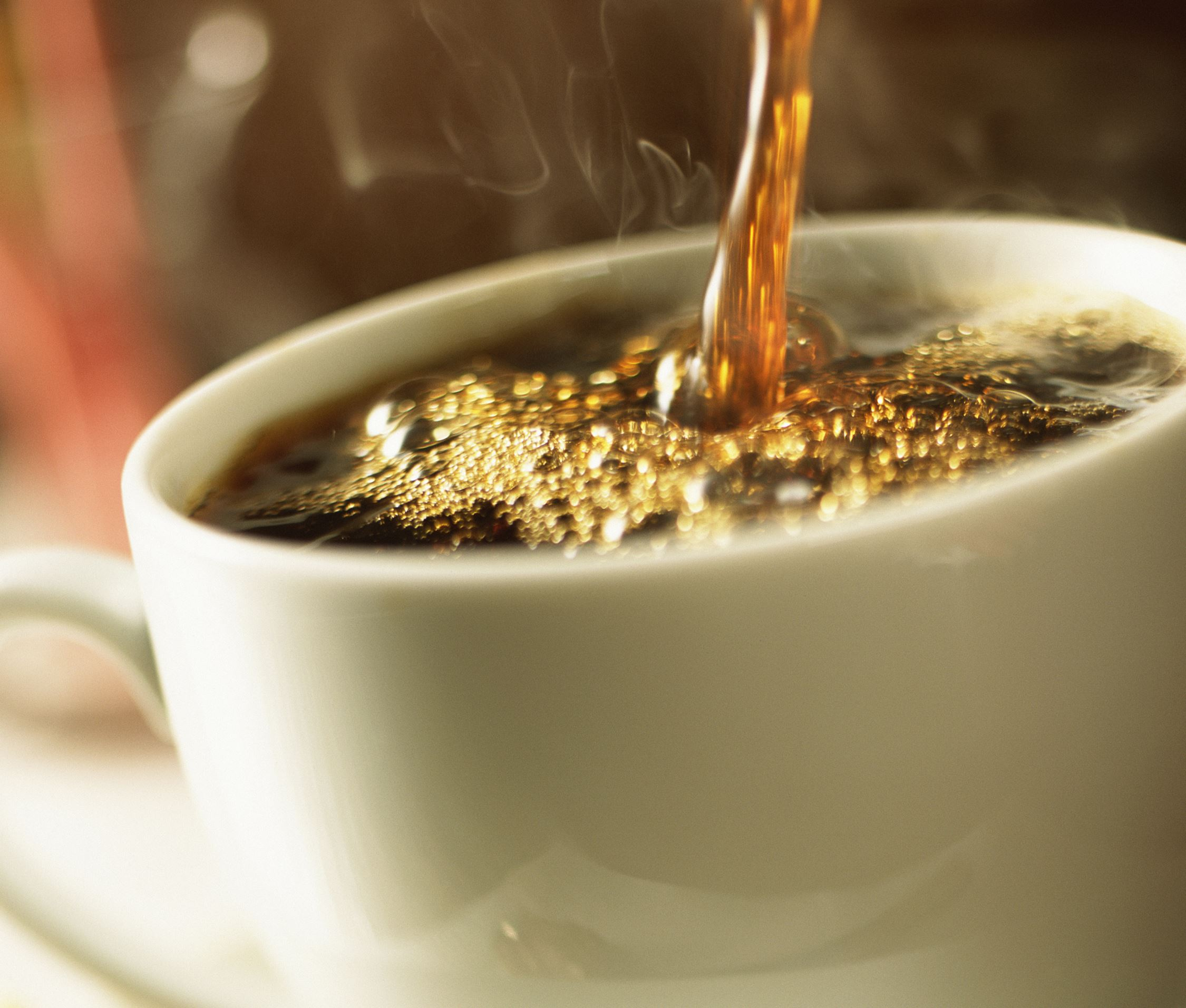 A cup of coffee being poured
