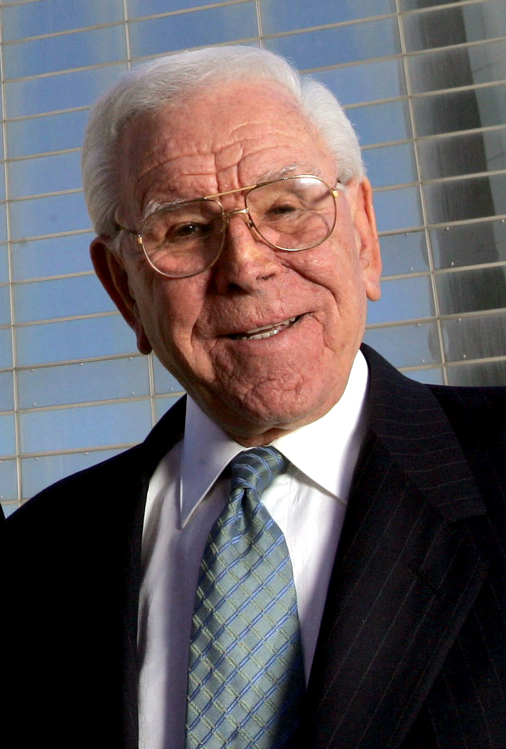 In this Feb. 9, 2006 file photo, Rev. Robert H. Schuller poses for a photo outside the Crystal Cathedral in Orange, Calif.