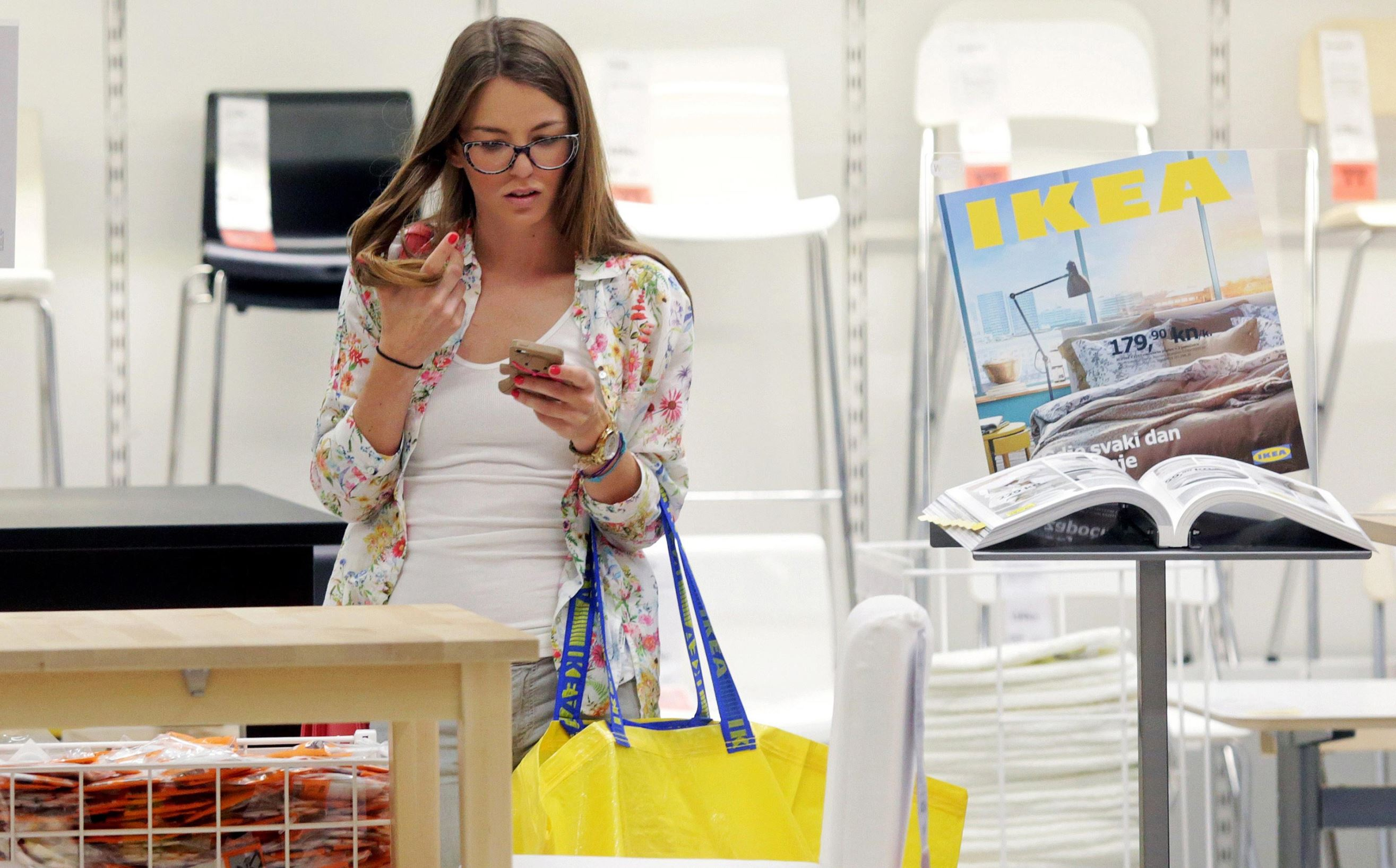 A customer shops at an IKEA store.