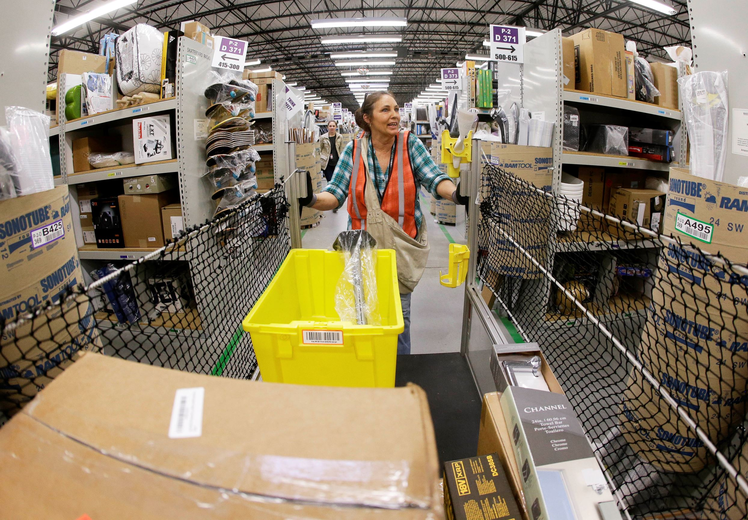 Theresa White fills orders at the Amazon fulfillment center in Lebanon