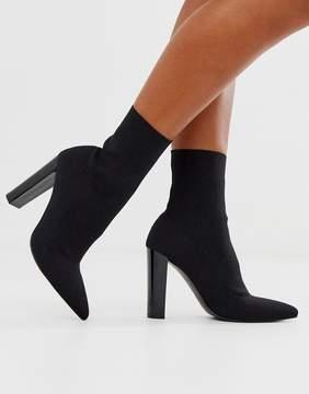 Asos Design ASOS DESIGN Enhance block heel sock boots in black knit