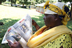 Sarah Onyango Obama reading Kenyan press coverage of the U.S. campaign at her rural homestead in Kogelo. Click image to expand.
