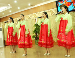 North Korean waitresses perform for patrons. Click image to expand.