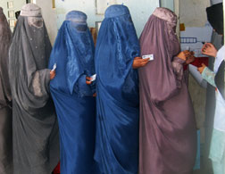 Afghan women learn how to vote. Click image to expand.