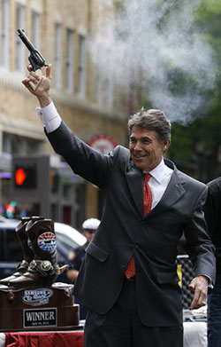 Texas Governor Rick Perry fires a six-shooter pistol in downtown Fort Worth. Click image to expand.