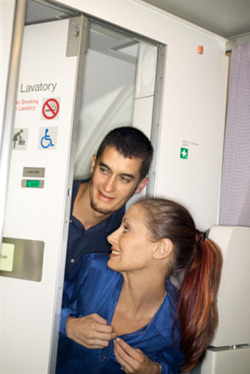 Couple sneaking into an airplane's lavatory. Click image to expand.