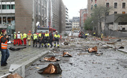 Firefighters work at the site of an explosion near government buildings in Norway's capital Oslo on July 22, 2011. Click image to expand.