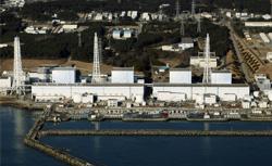 Quake-damaged Fukushima nuclear power plant in Futaba, Japan. Click image to expand.