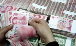 Money being counted at the Industrial and Commercial Bank of China Limited. Click image to expand.
