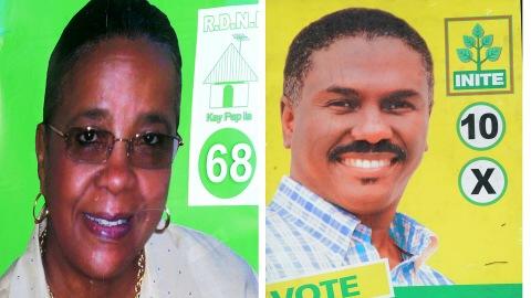 Pancartes de Mirlande Manigat et de Jude Célestin, en Haïti