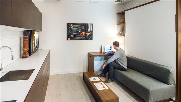 murphy bed in small living room decorating help designing spaces for the new reality