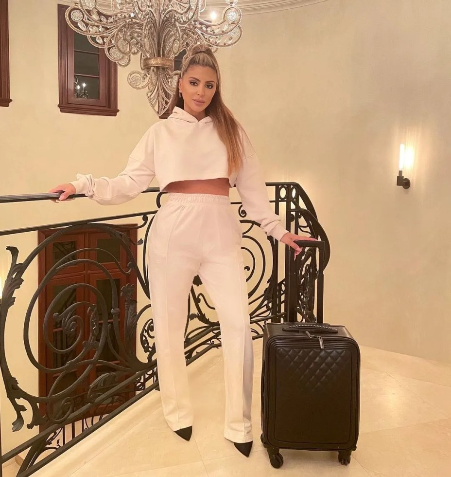 Larsa Pippen in a white hoodie and creased pants.