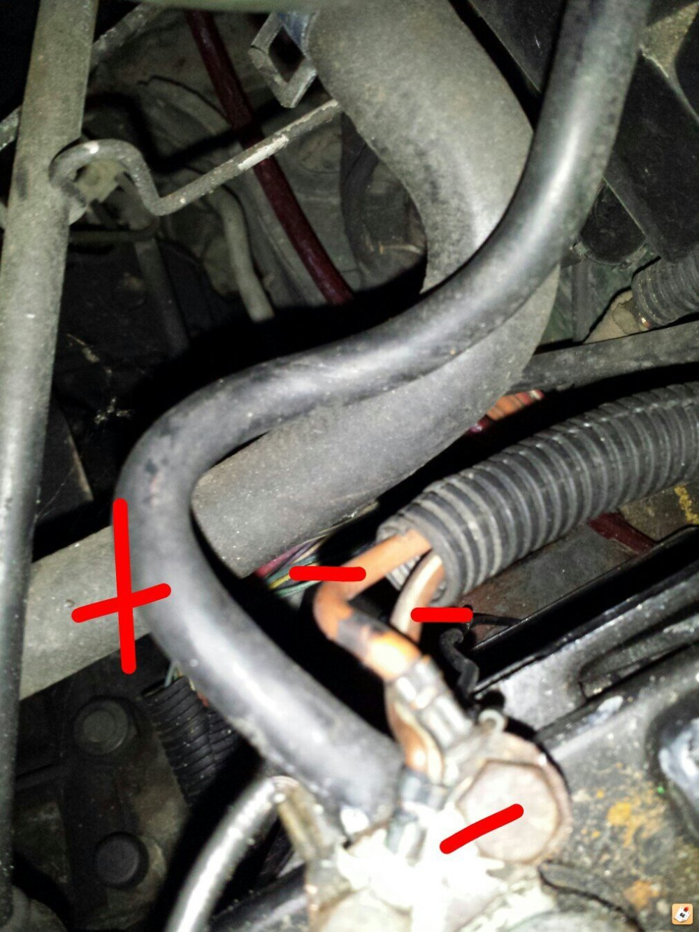 medium resolution of there are two red positive wires connected to it but the guys hand is in the way on my car this is where the negative cable connects to the negative side