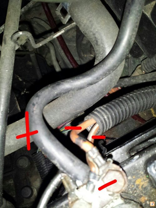small resolution of there are two red positive wires connected to it but the guys hand is in the way on my car this is where the negative cable connects to the negative side