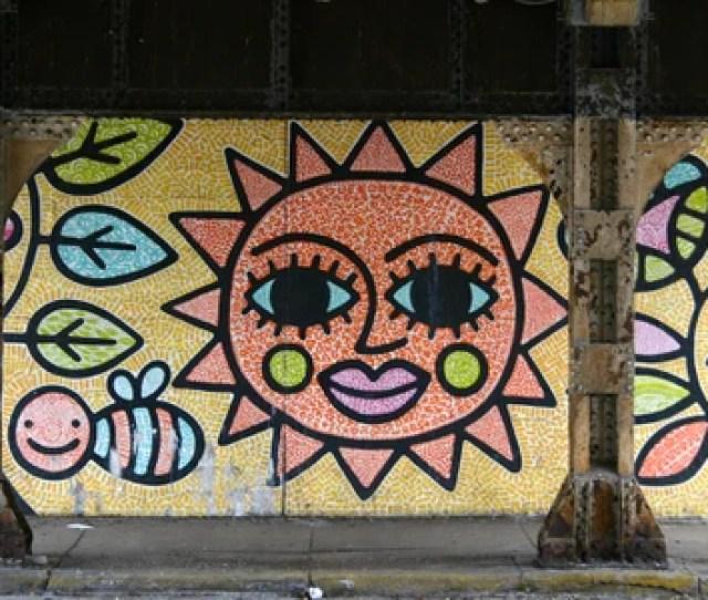 A Big Smiling Sun Greets Passersby Doug Pitorak