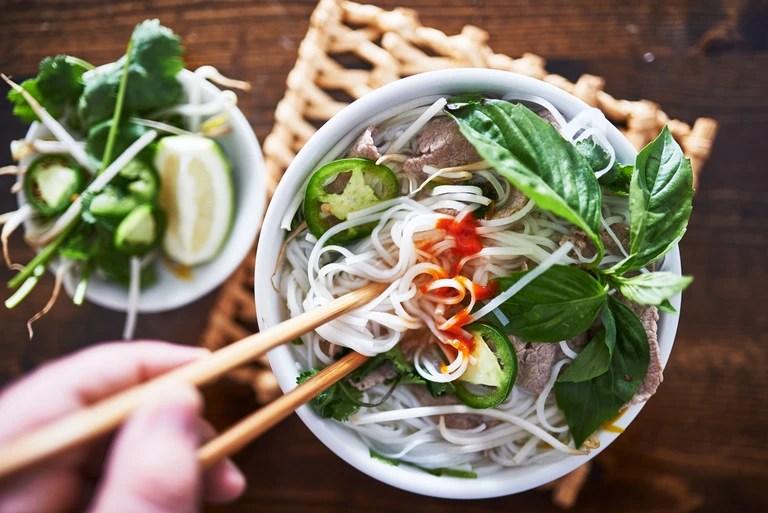 Vietnamese pho eaten with chopsticks.