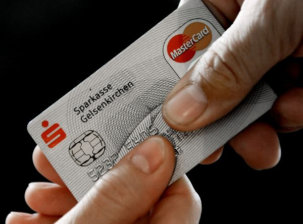In this Nov. 18, 2009, photo, a Mastercard chip-based credit card is posed for a photo in Gelsenkirchen, Germany. In the wake of recent high-profile data breaches, including this week's revelation that hackers stole consumer data from eBay's computer systems, Visa and MasterCard are renewing a push to speed the adoption of microchips into U.S. credit and debit cards. (AP Photo/Martin Meissner)